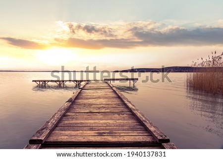 Sunset at over the pier at Lake Balaton Hungary . Stock photo ©