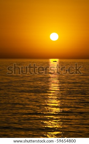 sunset at Petra beach with fishing boat