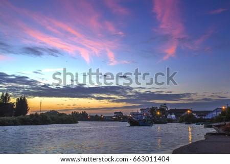 Sunset at Phu Hai wharf - Phan Thiet (the capital of Binh Thuan province, Vietnam) #663011404