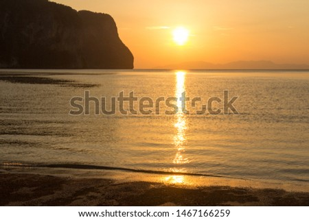 Sunset at Rajamangala beach in Trang province, Thailand