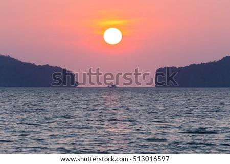 Sunset at sea and orange light. #513016597