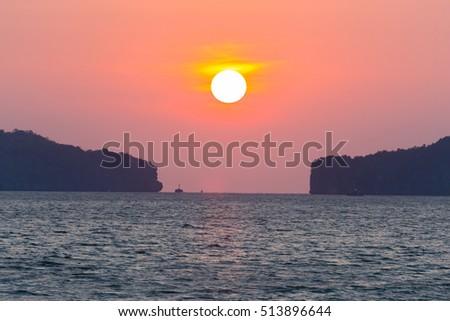 Sunset at sea and orange light. #513896644