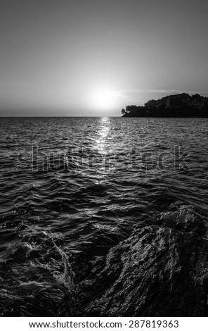 sunset at sea black and white