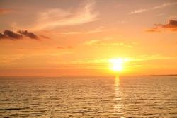 sunset at sea. variety of colors and hues of the rising sun