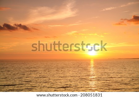 sunset at sea. variety of colors and hues of the rising sun #208051831
