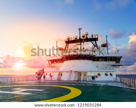 sunset at sea with view of modern offshore rov / construciton support vessel #1219031284
