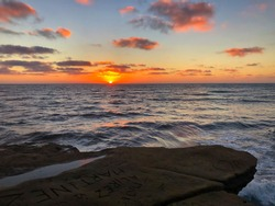 Sunset at Sunset Cliffs National Park in San Diego. Sun Goes Down in California with Pacific Ocean.