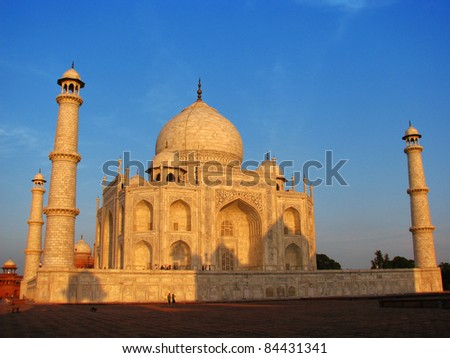 Sunset at Taj Mahal, the amazing mausoleum in Agra (India), one of the highlights of worldwide architecture of all times.