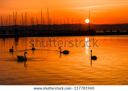 Sunset at the beach with red sky and mountain - stock photo
