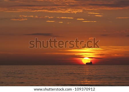 Sunset at the beach with ship
