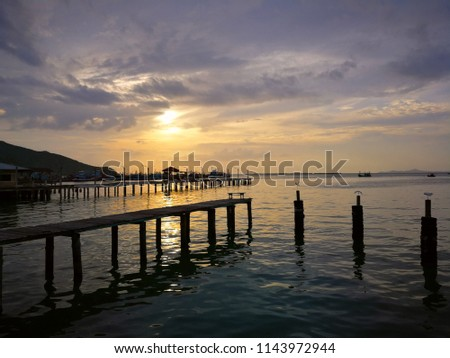 Sunset at the beach with wooden bridge #1143972944