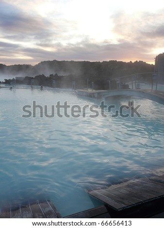 Sunset at the Blue Lagoon, Iceland. It's a steaming hot wellness bath, heated by geothermal energy. Characteristic milk-blue color by the silica on the bottom.
