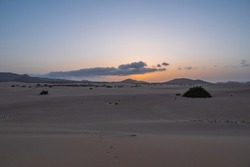 Sunset at the Dunes El Jable of National Park de Corralejo, Fuerteventura. October 2019