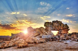 Sunset at the famous rock formation 'La Fenetre' near Isalo, Madagascar. HDR