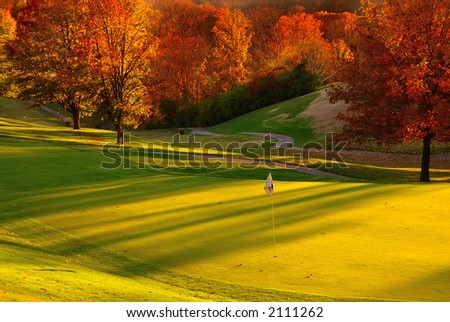 Sunset at the Golf Course - The sun sets on a putting green at the golf course in Autumn.