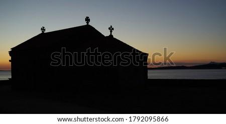 Sunset at the hermitage of the Virgen de la Lanzada in O Grove, Pontevedra.                                Stok fotoğraf ©
