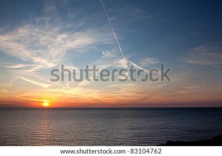 Sunset at the ocean near Cap Frehel Brittany France - stock photo