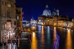 Sunset at the 17th-century Santa Maria di Salute Basilica, from Academia bridge Puente de la academia on Grand Canal in Venice, Italy