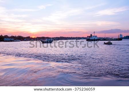 Sunset at the Yangon river in Yangon Myanmar #375236059