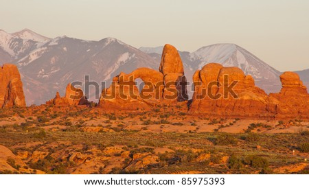 Sunset at Turret Arch with La-Sal Mountains. Arches National Park, Utah
