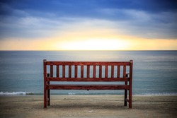 Sunset beach and bench