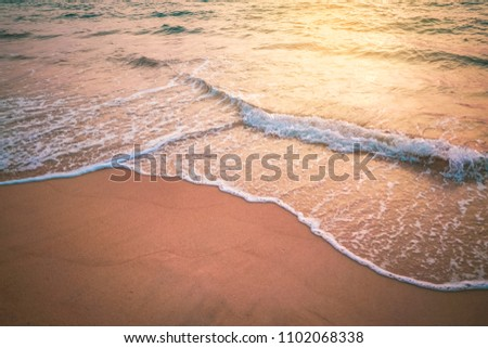 Sunset beach and smooth wave abstract texture background. Copy space of summer vacation and business travel relax concept. Vintage tone filter effect color style.