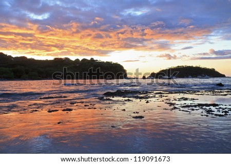 Sunset behind Punta Gorda on Playa Ocotal on the Pacific Ocean in Guanacaste, Costa Rica