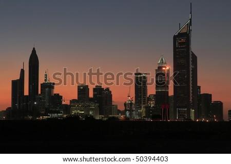 Sunset behind skyline of Dubai