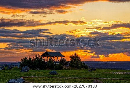 Sunset behind the clouds view. Sunset sky. Sunset sky clouds landscape. Cloudy sky at sunset