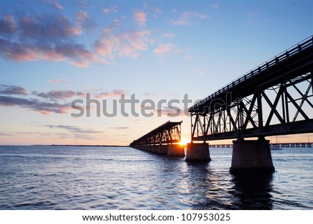 Sunset behind the historic railroad bridge at Bahia Honda State Park in the Florida Keys