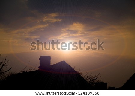 sunset behind the old house