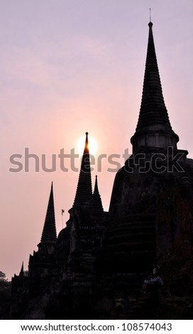 Sunset behind the temples at Ayutthaya - stock photo
