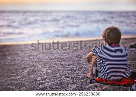 sunset boy on the beach sea summer sorrow #256238680
