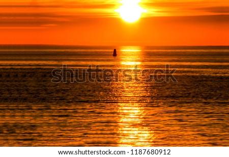 Sunset buoy water horizon panorama. Sunset buoy view. Buoy sunset horizon. Sunset buoy water reflection