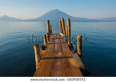 Sunset by the Atitlan Lake with an embarkation pier used by fishermen close to Panajachel, Guatemala.