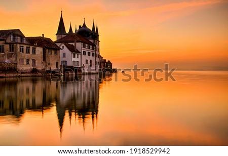 Sunset castle lake water reflection. Sunset lake castle reflection. Sunset caslte lake. Sunset lake castle panorama