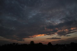 Sunset Clouds in Village after Rain