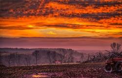 Sunset cloudy sky over foggy field. Sunset field fog landscape. Sunset field fog. Foggy field at sunset