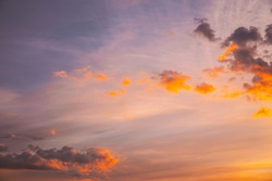 Sunset Cloudy Sky With Fluffy Clouds. Sunset Sky Natural Background. Sunrays, sunray, ray, Dramatic Sky. Sunset In Yellow, Orange, Pink Colors. Summer summertime background.