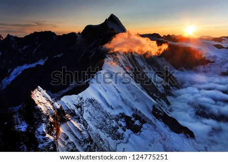 Sunset colours in the Pennine Alps, seen from Monte Cervino (4478m), Italy