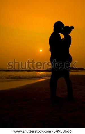 couple kissing sunset. stock photo : Sunset couple