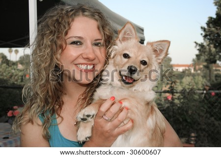 Sunset, Dog and girl together in the garden
