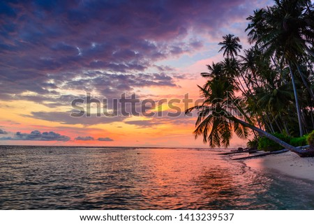 Sunset dramatic sky on sea, tropical desert beach, no people, colorful clouds, travel destination, Indonesia Banyak Islands Sumatra