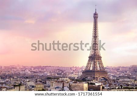 Sunset Eiffel tower and Paris city view form Triumph Arc. Eiffel Tower from Champ de Mars, Paris, France. Beautiful Romantic background.