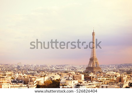 Sunset Eiffel tower and Paris city view form Triumph Arc. Eiffel Tower from Champ de Mars, Paris, France. Beautiful Romantic background.