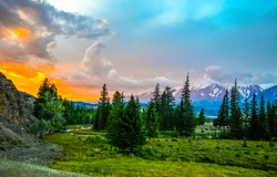 Sunset evening forest sky clouds landscape. Mountain valley evening sunset. Sunset sky over mountain valley in evening