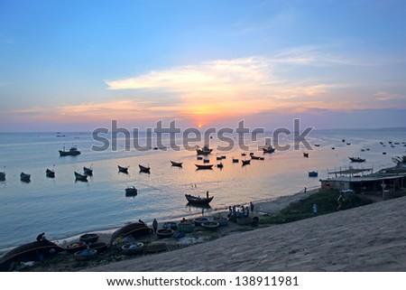 Sunset. Fishing boats in Mui Ne harbor. Vietnam