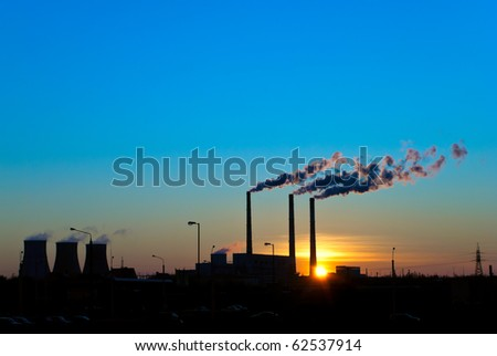 Sunset for smoking factory pipes