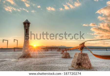 Sunset from a roof top with a roof vent and grounding cable