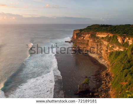 Sunset from the Pura Uluwatu temple on Bali island in Indonesia